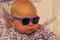Baby with sunglasses on.